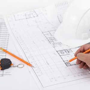 architect-working-on-blueprint-partner-working-drawings-indoors-man-light-measuring-structure-table_t20_RzOrPB.comp